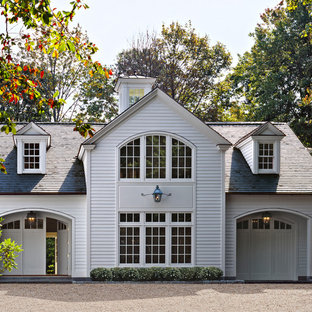 Example of a classic white two-story exterior home design in New York with a hip roof and a shingle roof