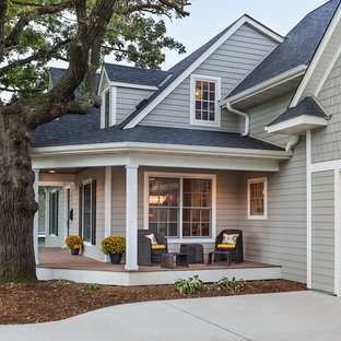 Mid-sized transitional gray two-story concrete fiberboard gable roof idea in Minneapolis