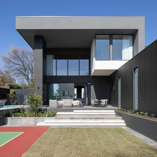 Contemporary two-storey grey house exterior in Melbourne with a flat roof.