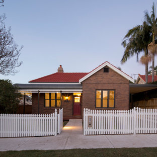 Design ideas for a mid-sized traditional one-storey brick brown house exterior in Sydney with a gable roof and a tile roof.