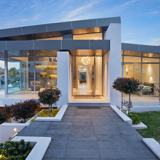 Design ideas for a contemporary house exterior in Sydney with a shed roof.