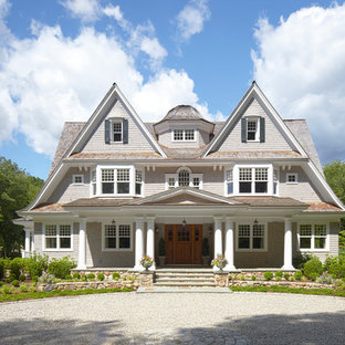 Example of a large ornate gray three-story wood gable roof design in New York with a shingle roof