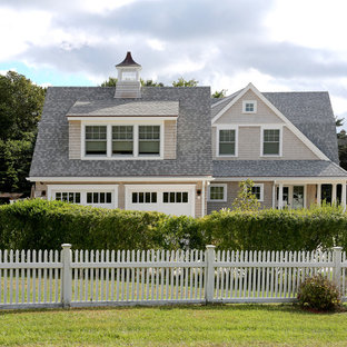 Example of a country exterior home design in Boston