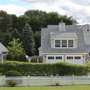 Inspiration for a cottage gray two-story wood exterior home remodel in Boston