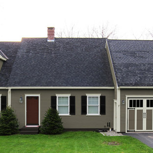 Example of a small classic beige one-story wood exterior home design in New York