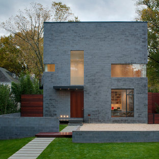 Идея дизайна: серый дом в стиле модернизм с плоской крышей