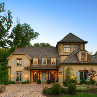 Inspiration for a mid-sized mediterranean two-story exterior home remodel in DC Metro