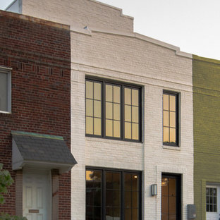 Example of a mid-sized minimalist white two-story brick exterior home design in DC Metro with a green roof