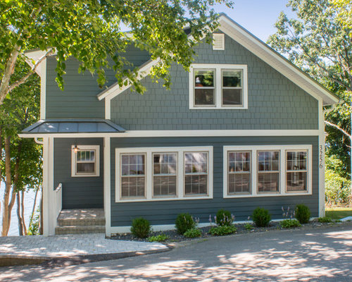 large beach style blue two story gable roof idea in milwaukee with a metal roof - Exterior House Colors Blue
