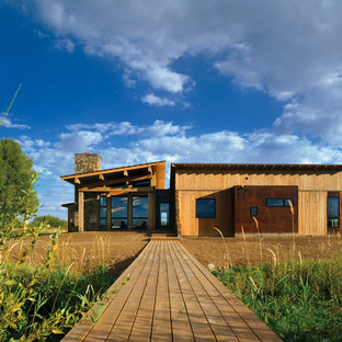 Rustic wood exterior home idea in Salt Lake City with a shed roof