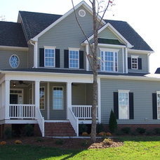 Traditional Exterior by EMK CONSTRUCTION, INC.