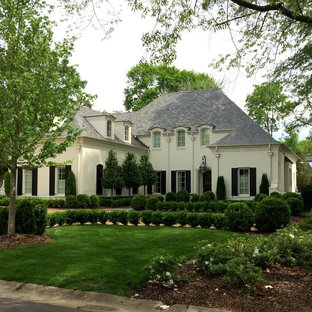 French country exterior home photo in Birmingham with a hip roof