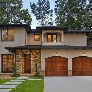 Mid-sized mediterranean beige two-story mixed siding exterior home idea in Atlanta