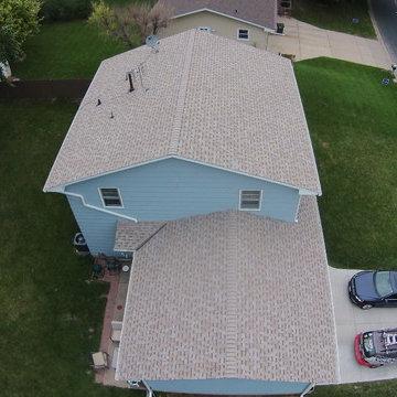 "New Owens Corning ""Amber"" color asphalt shingle roof."