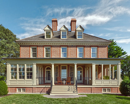 Traditional Red Two Story Brick Exterior Home Idea In Baltimore With A Hip  Roof And