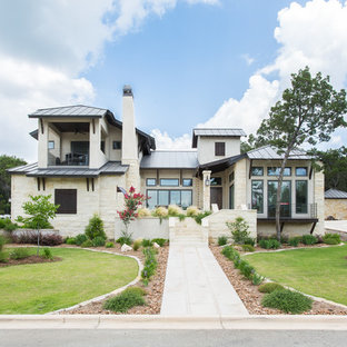 Huge transitional white two-story stone exterior home photo in Austin