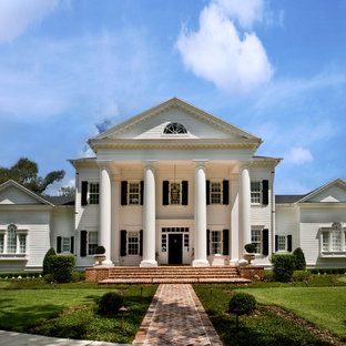Inspiration for a huge victorian white three-story wood house exterior remodel in Orlando