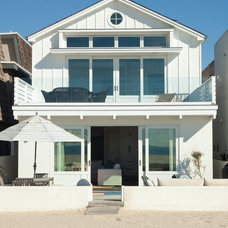 Beach Style Exterior by William Guidero Planning and Design