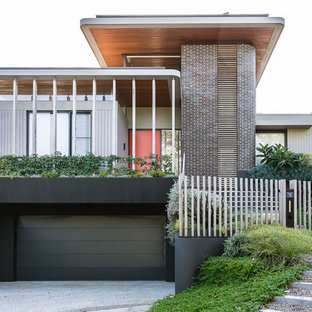 Contemporary multi-coloured house exterior in Sydney with a flat roof.