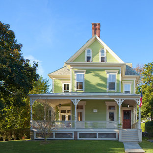 Inspiration for a large victorian green three-story gable roof remodel in Providence