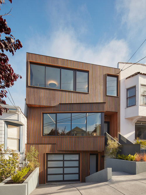 Mid-sized trendy brown three-story wood flat roof photo in San Francisco