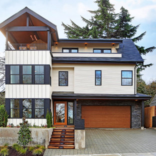 Large scandinavian white three-story house exterior idea in Seattle