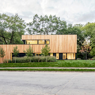 Inspiration for a modern brown two-story flat roof remodel in Other