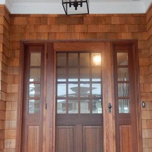 Foto de fachada de casa beige, costera, de tamaño medio, de tres plantas, con revestimiento de madera, tejado a doble faldón y tejado de teja de madera