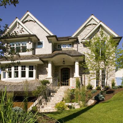 Elegant stone exterior home photo in Minneapolis