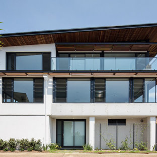 This is an example of a beach style exterior in Sydney with three or more storeys.