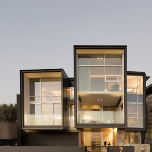 Inspiration for a contemporary three-storey house exterior in Sydney with a flat roof.