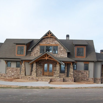 Inspiration for a large craftsman gray two-story mixed siding gable roof remodel in Atlanta