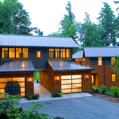 Inspiration for a contemporary wood exterior home remodel in Seattle with a metal roof