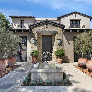 Trendy stucco exterior home photo in Orange County