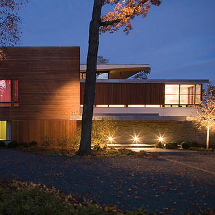 Inspiration for a large modern gray two-story mixed siding exterior home remodel in Chicago with a clipped gable roof