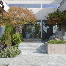Contemporary Exterior by John Stewart Designs