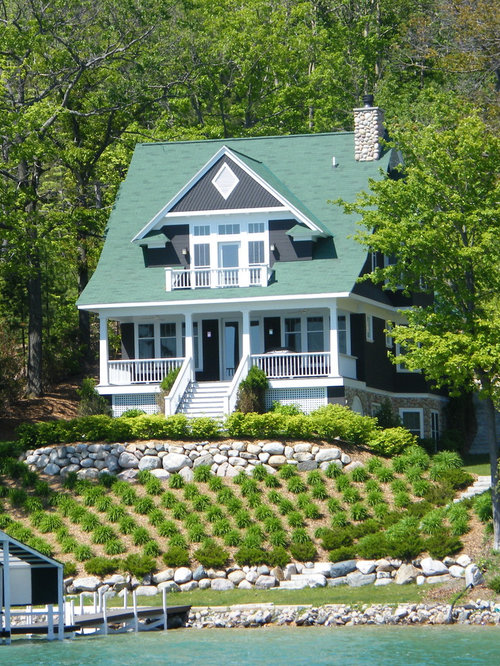 Mid sized beach style exterior design ideas remodels photos for Beach cottage exterior design