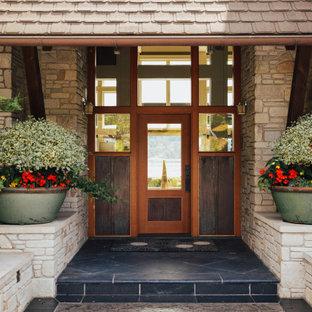 Свежая идея для дизайна: огромный, двухэтажный, бежевый частный загородный дом с облицовкой из камня и красной крышей - отличное фото интерьера
