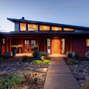 Inspiration for a mid-sized modern red one-story concrete fiberboard exterior home remodel in Portland