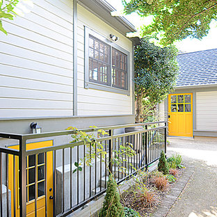 Inspiration for a timeless wood exterior home remodel in Portland
