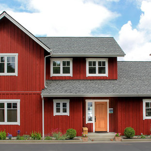 Example of a mid-sized danish red two-story wood gable roof design in Seattle