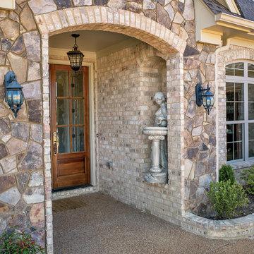 Nottingham Tudor Brick & Tennessee Fieldstone Rock Home - Tennessee