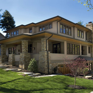 Large arts and crafts beige two-story stone flat roof photo in Seattle