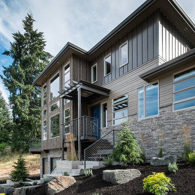 Inspiration for a large contemporary brown three-story wood exterior home remodel in Portland with a hip roof