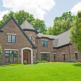 Inspiration for a large timeless brown two-story brick exterior home remodel in Other