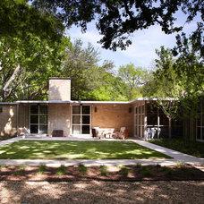 Midcentury Exterior by Bauhaus Custom Homes