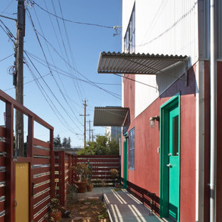 Small eclectic multicolored two-story apartment exterior idea in San Francisco with a shed roof