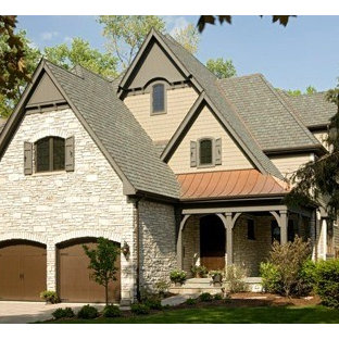 Example of a mid-sized classic beige two-story mixed siding gable roof design in Chicago