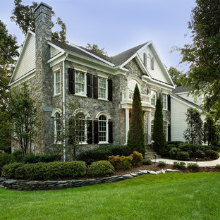 Example of a large classic gray two-story mixed siding gable roof design in DC Metro