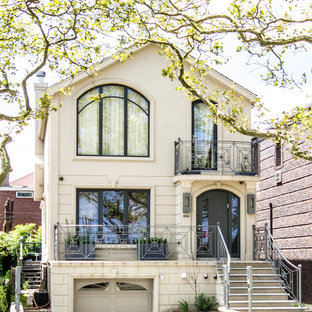 Inspiration for a timeless stucco exterior home remodel in New York